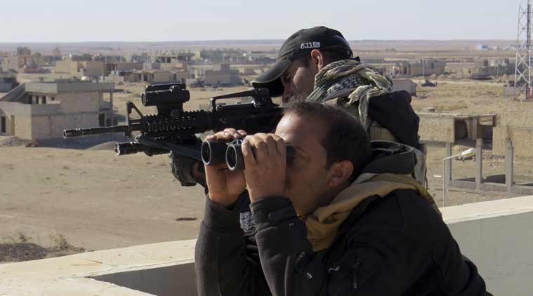 Soldiers of Iraq anti-terrorism forces watch movements during a military operation to regain control of the western suburbs of Ramadi. (Source: AP)