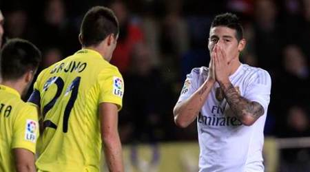 Real Madrid's James Rodriguez, right, reacts after failing to score against Villarreal during a Spanish La Liga soccer match at the Madrigal stadium in Villarreal, Spain, Sunday, Dec. 13, 2015. (AP Photo/Alberto Saiz)