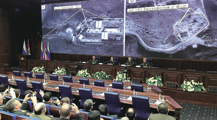Top Russian military officials display, to reporters in Moscow on Wednesday, satellite images of alleged oil trucks at the Syria-Turkey border. (Source: AP)
