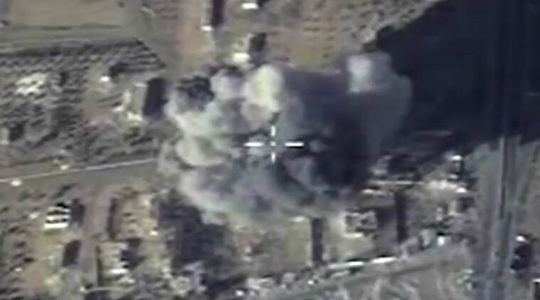 In this photo made from the footage taken from Russian Defense Ministry official web site and provided Wednesday, Dec. 9, 2015 an aerial image shows cruise missile strike on a local ISIS headquarters in Syria. (Russian Defense Ministry Press Service via AP)