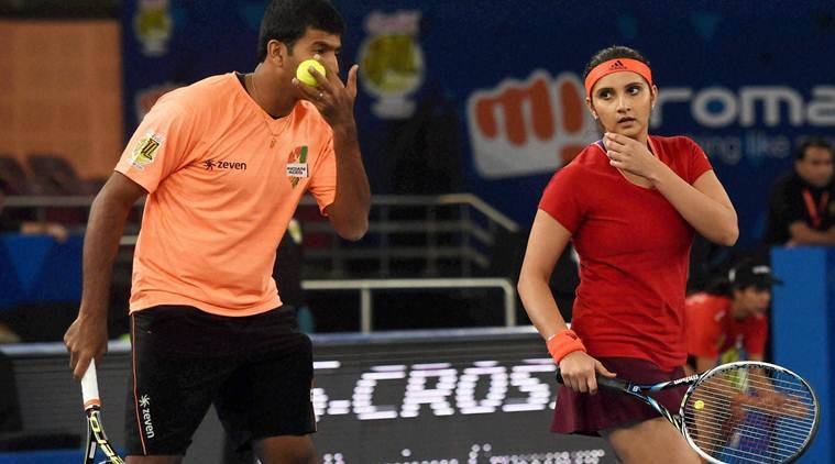 New Delhi: Sania Mirza and Rohan Bopanna of Micromax Indian Aces in action during the International Premier Tennis League (IPTL) match at the IG Stadium in New Delhi on Friday. PTI Photo by Atul Yadav  (PTI12_11_2015_000335B)