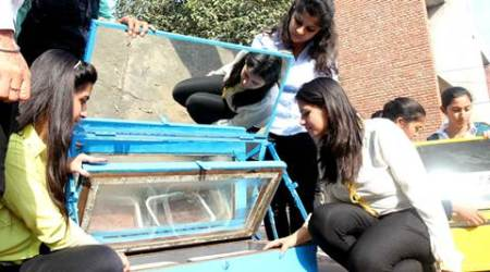 Students at Punjab Agri University sell cakes baked in solarcookers