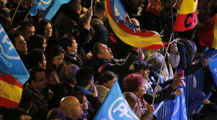 Popular Party supporters shout slogans outside the party's headquarters following the national elections in Madrid, Sunday, Dec. 20, 2015. (AP Photo)