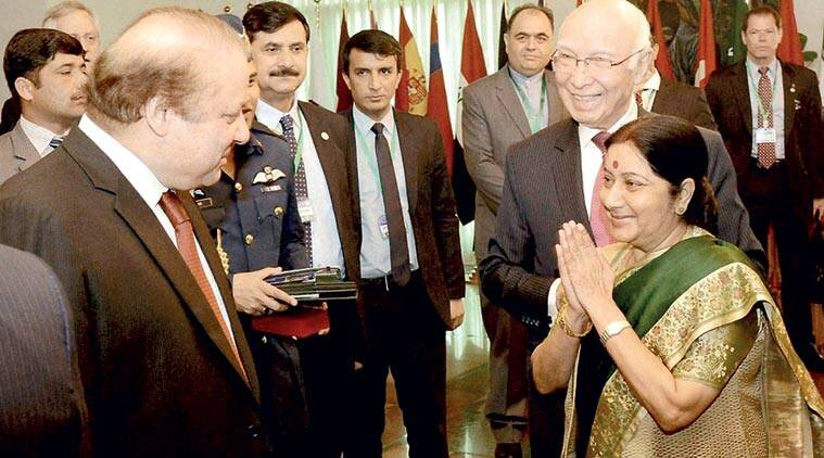 Sushma Swaraj with Nawaz Sharif and Sartaj Aziz in Islamabad Wednesday. (Source: PTI)