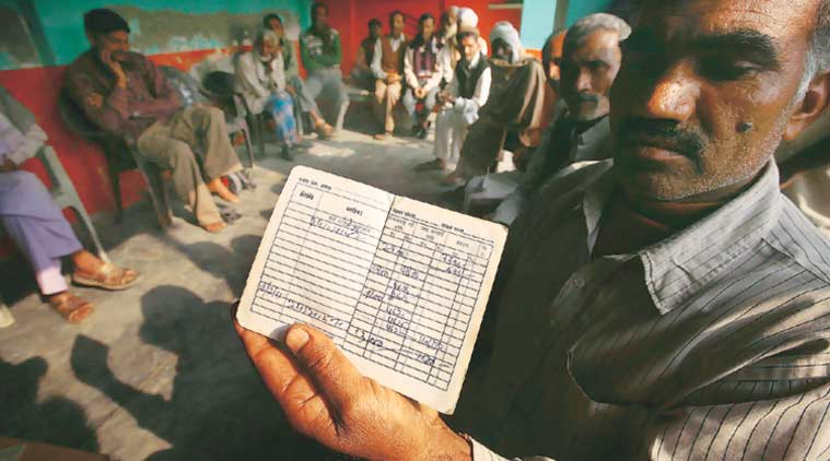 A farmer displaying the DBT credit entry in his bank passbook.(Express Photo by: Praveen Khanna)