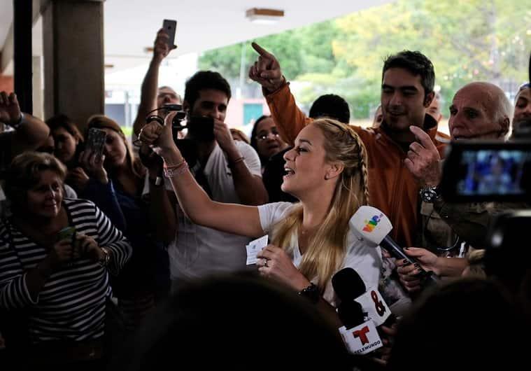 Lilian Tintori wife of jailed Venezuelan opposition leader Leopoldo Lopez, center, Freddy Guevara, of the Voluntad Popular party, right, and former opposition congresswoman Maria Corina Machado, left, celebrate in Caracas, Venezuela. AP Photo