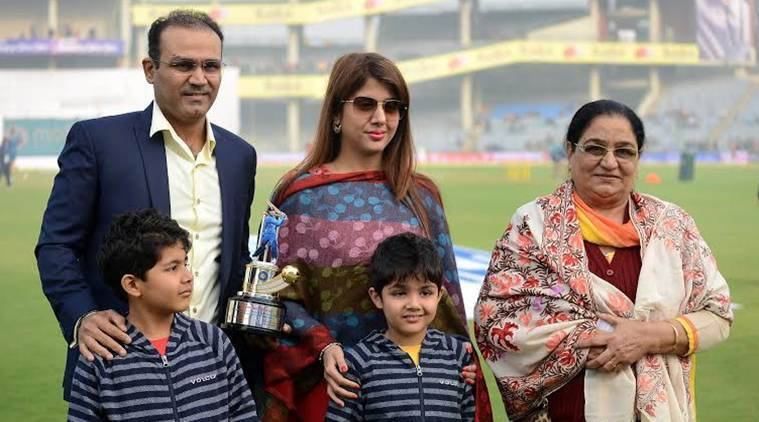 Former indian cricketer Varinder Sehwag with his family members after felicitate by BCCI before start the India-South Africa fourth test match at Feroze Shah Kotla stadium in New Delhi on Dec 3rd 2015. Express photo by Ravi Kanojia