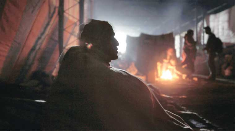 People in Shakurbasti take refuge under a railway yard. (Express  Photo by: Oinam Anand)