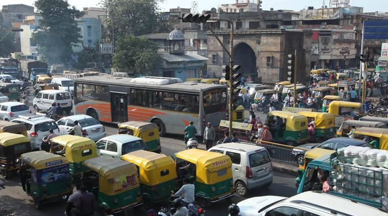 The commuters are stuck at Raipur Darwaja in a long traffic jam. Due to such jams commuters throng BRTS lane as well. Express Photo by Javed Raja. 17.10.2014.