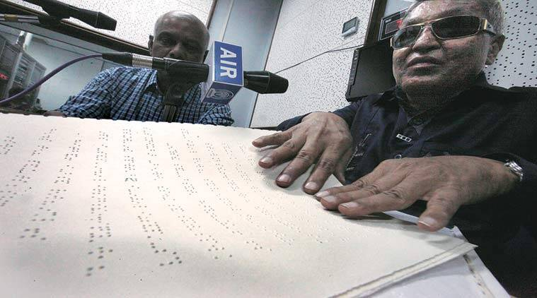 62-year-old Dhanraj Patil, who used to teach languages and philosophy to prisoners in Yerawada jail, reads out the second-half of the news at All India Radio, Pune, on Monday.  (Arul Horizon)