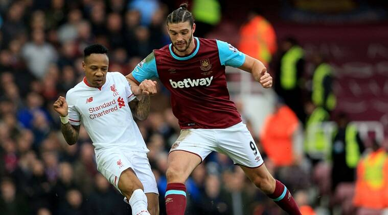 Liverpool's Nathaniel Clyne, left, and West Ham United's Andy Carroll battle for the ball during the English Premier League soccer match against West Ham United at Upton Park, London, Saturday Jan. 2, 2016. (Adam Davy/PA via AP) UNITED KINGDOM OUT NO SALES NO ARCHIVE