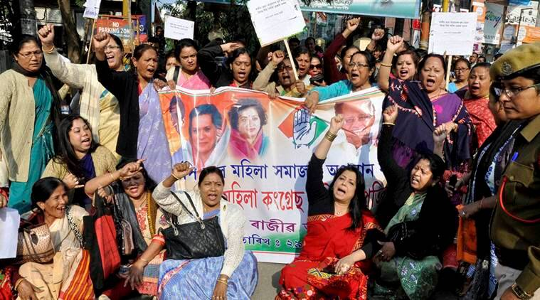 Guwahati: Assam Pradesh Mahila Congress Committee block the GS road during a protest against BJP leader Himanta Biswa Sharma for his alleged involvement in the Monday's Rajiv Bhawan attack by the BJP workers, in Guwahati on Tuesday. PTI Photo(PTI12_29_2015_000101A)