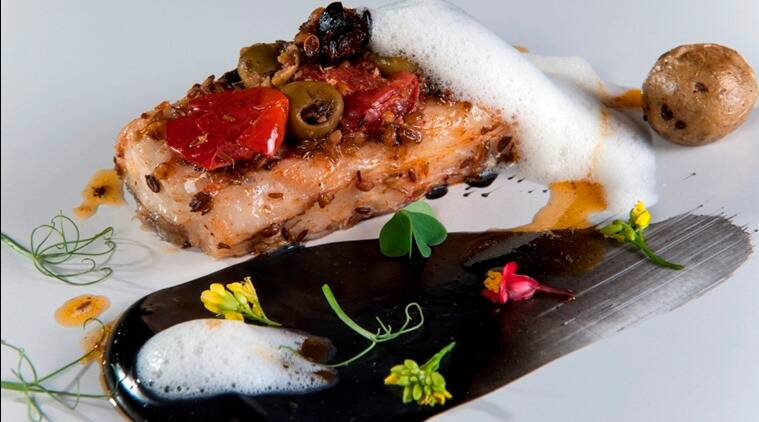 Baked Sea Bass with Olives, Tomato and Lime Foam.