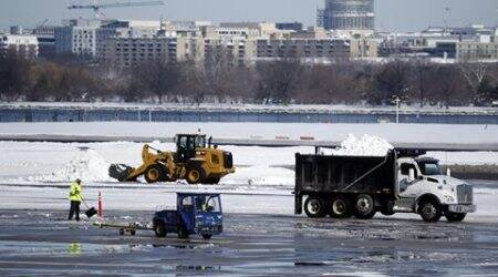 US blizzard: Major East Coast airports slowly resume service