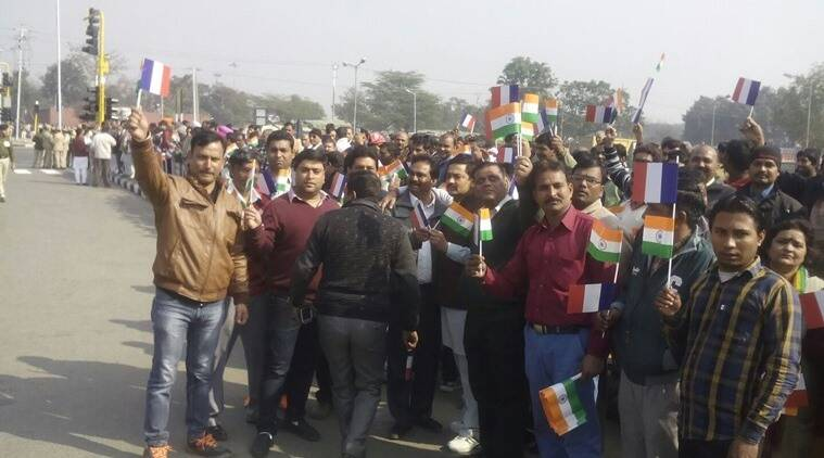 BJP workers gather at a traffic intersection in Chandigarh waiting to greet President Hollande. Express Photo
