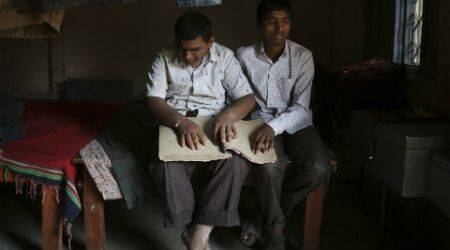 Visually challenged students face shortage of braille books, reading assistants