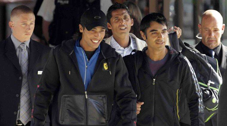 """""""Pakistan cricket players Mohammad Amir, second left, Salman Butt, fourth left, and Mohammad Asif, third left, walk to a taxi flanked by security men, as they leave their hotel in Taunton, England, Wednesday, Sept. 1, 2010. The three Pakistani cricketers who are implicated in match-fixing allegations are on their way to London for an internal inquiry with Pakistani officials"""" *** Local Caption *** """"Pakistan cricket players Mohammad Amir, second left, Salman Butt, fourth left, and Mohammad Asif, third left, walk to a taxi flanked by security men, as they leave their hotel in Taunton, England, Wednesday, Sept. 1, 2010. The three Pakistani cricketers who are implicated in match-fixing allegations are on their way to London for an internal inquiry with Pakistani officials. AP Photo"""""""
