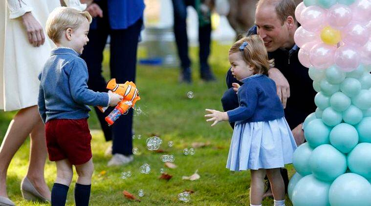 Britain's Prince William and Princess Charlotte look on as Prince George plays with a bubble gun at a children's party at Government House in Victoria. (File/AP)