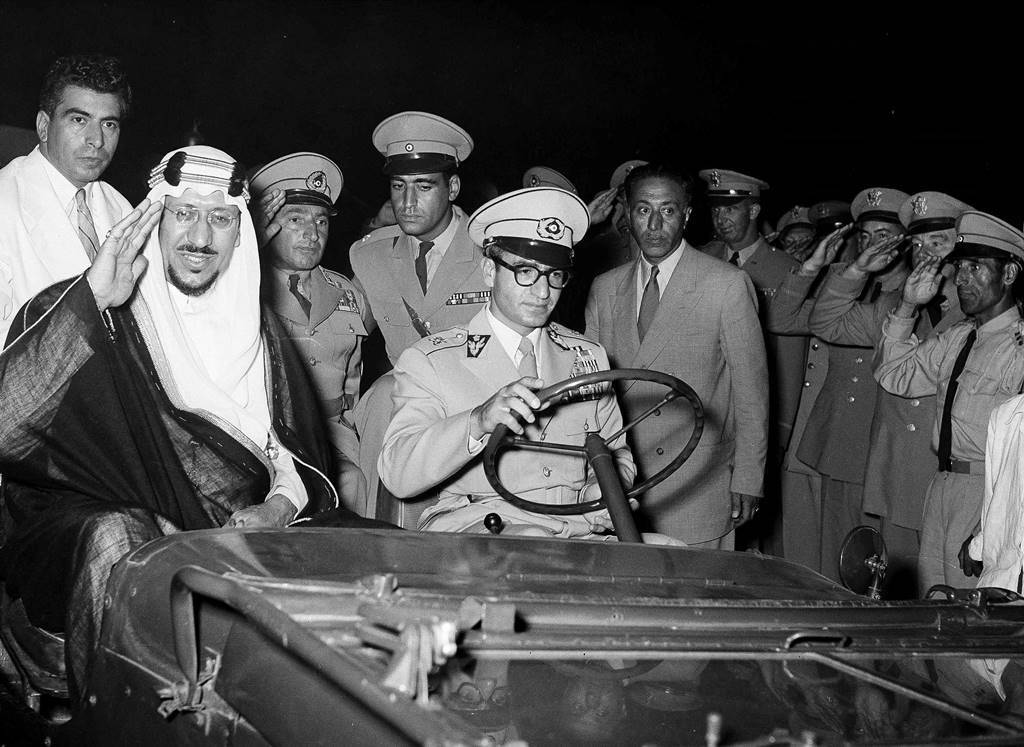 In this Aug. 18, 1955 file photo, King Saud of Saudi Arabia and his host, the Shah of Iran, travel by jeep on the way to view Iranian army maneuvers. King Saud was paying a state visit to his Persian Gulf neighbor. Diplomatic relations between Iran and Saudi Arabia have been tense since the 1979 Islamic Revolution, though there have been occasional thaws between the two rivals.(AP Photo, File)