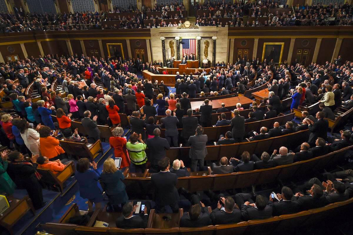 Obama is applauded as he gives his State of the Union address before a joint session of Congress on Capitol Hill in Washington. (AP Photo/Susan Walsh)