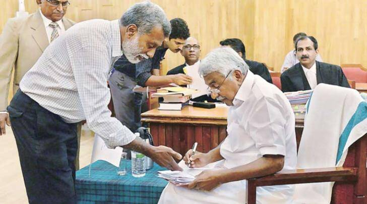 Chandy appears before the commission, Monday. (PTI Photo)