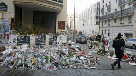 Fronting an armed deity, Charlie Hebdo declares itselfalive