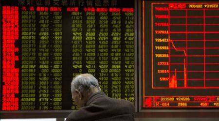 China stocks plunge, triggering another market halt
