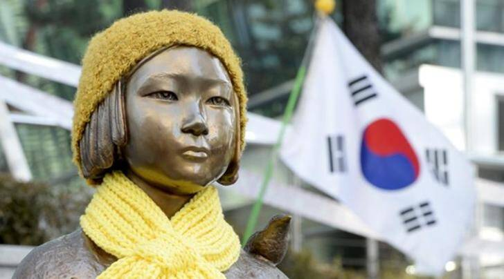 "A statue of a girl that represents the sexual victims by the Japanese military is seen in front of Japanese embassy in Seoul, South Korea, December 28, 2015. One test of the commitment by Japan and South Korea to resolve the ""comfort women"" issue may be the fate of a statue in front of Tokyo's embassy in Seoul. The bronze of a barefoot teenage girl in a traditional hanbok dress, sitting on a chair with fists clenched on her lap and an empty chair beside her, has become a symbol of ""comfort women"", as those who were forced to work at Japan's wartime military brothels are euphemistically known.  REUTERS/Ahn Eun-na/News1  ATTENTION EDITORS - FOR EDITORIAL USE ONLY. NOT FOR SALE FOR MARKETING OR ADVERTISING CAMPAIGNS. THIS IMAGE HAS BEEN SUPPLIED BY A THIRD PARTY. IT IS DISTRIBUTED, EXACTLY AS RECEIVED BY REUTERS, AS A SERVICE TO CLIENTS. SOUTH KOREA OUT. NO COMMERCIAL OR EDITORIAL SALES IN SOUTH KOREA. NO RESALES. NO ARCHIVES."