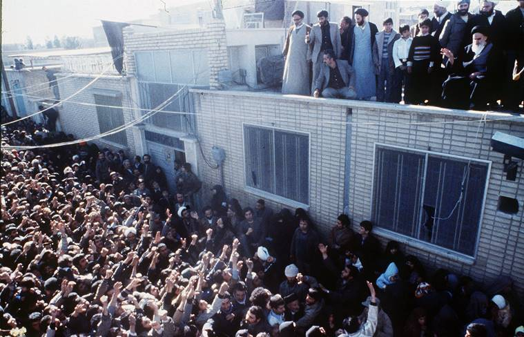 In this undated 1979 file photo, Iran's new leader, Ayatollah Khomeini waves at the crowd at Qom, Iran. After the overthrow of the shah and takeover of the U.S. Embassy in Tehran, Saudi Arabia quickly became America's top ally in the region.(AP Photo, File)