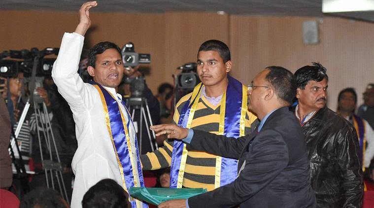Lucknow: Two students raising slogan against PM Narendra Modi at the convocation of BR Ambedkar university in Lucknow on Friday. PTI photo.
