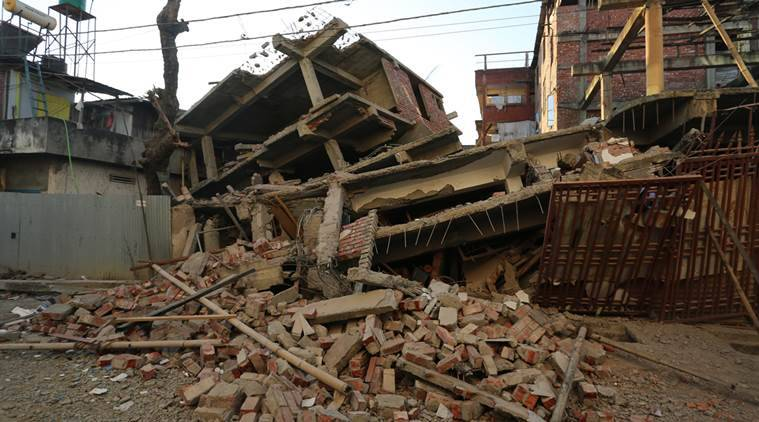 An under construction building that got damaged in the earthquake in Imphal, Manipur on Monday. Express photo by Deepak Shijagurumayum. 04 January 2016