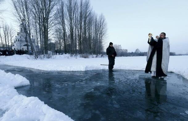 People plunge into ice cold water to celebrate Epiphany around the world