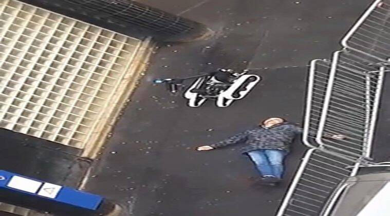 In this image taken from a validated UGC video the body of man lies on the ground near a police robotic device after the he was shot dead by officers at a police station in northern Paris. Thursday, Jan. 7, 2016. Tensions in France, under a state of emergency since a wave of attacks on Nov. 13, have been even higher this week as the anniversary of the January attacks approached. (AP Photo)
