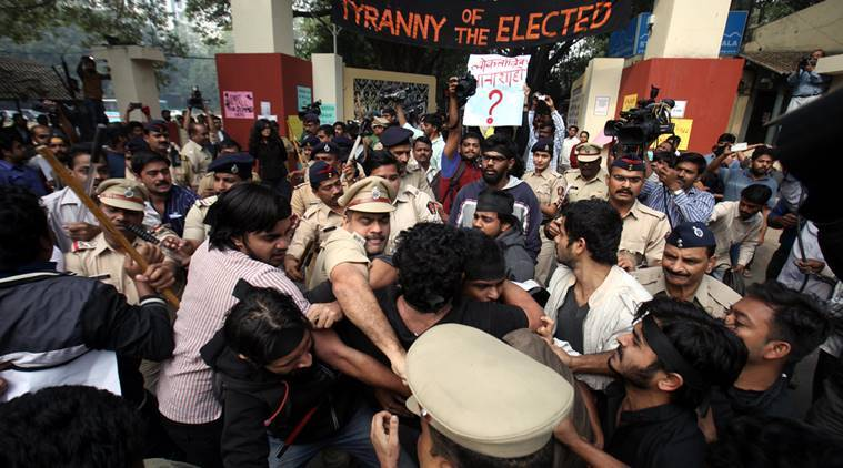Police action against the FTII students who were protesting against Gajendra chauhan prior to his arrival at FTII on Thursday. Express Photo by Arul Horizon, 07-01-2016, Pune