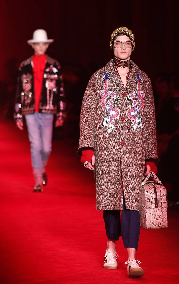 Models wear creations for Gucci men's Fall-Winter 2016-2017 collection, part of the Milan Fashion Week, unveiled in Milan, Italy. (Photo: AP)