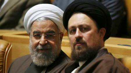 FILE - In this April 12, 2015 file photo, Iranian President Hassan Rouhani, left, talks to Hassan Khomeini, grandson of late revolutionary founder Ayatollah Khomeini, in a ceremony to commemorate the late Khadijeh Saghafi, wife of Ayatollah Khomeini, in Tehran, Iran. Hassan Khomeini has been barred from running for the Assembly of Experts election, his family said Tuesday, Jan. 26, 2016, as the country prepares for crucial elections next month. (AP Photo/Vahid Salemi, File)