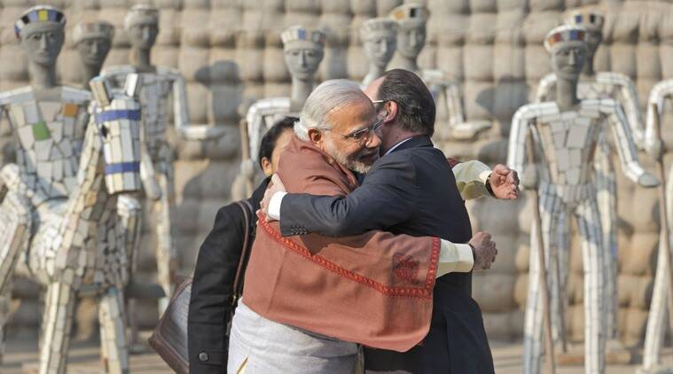 Prime Minister Narendra Modi, left and French President Francois Hollande greet each other at the Rock Garden in Chandigarh, India, Sunday, Jan. 24, 2016. Hollande began a three-day visit to India on Sunday that could push a multibillion-dollar deal for combat airplanes and closer cooperation on counterterrorism and clean energy. (AP Photo/Manish Swarup)