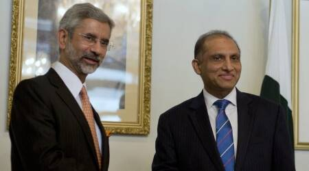 File Photo: Indian Foreign Secretary Subrahmanyan Jaishankar, left, poses for photographers, as he shakes hands with his Pakistani counterpart Aizaz Chaudhry at the foreign ministry in Islamabad. (Source: AP)