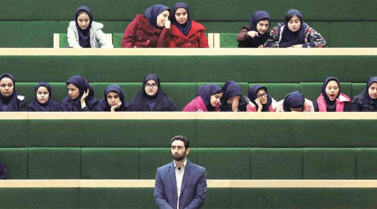 School girls follow the address of President Hassan Rouhani in Parliament, Tehran on Sunday. (Source: AP)