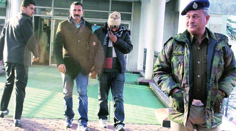 Contractor Akshay Doegar (face covered) outside the high court in Shimla on Friday.  Lalit Kumar