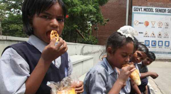 Students of a Government School having Junk food from their scho , junk food at school canteen. (Express photo by Jasbir Malhi)