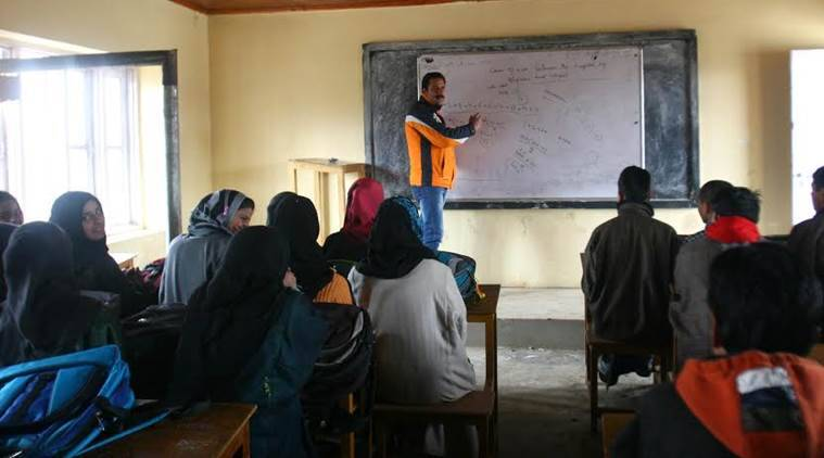 Teacher delivers a lecture at Higher Secondary School Kunzer in North Kashmir as it has been turned into a coaching centre during winter vacations as part of CM's 50 initiative. Express Photo by Shuaib Masoodi 06-01-2016