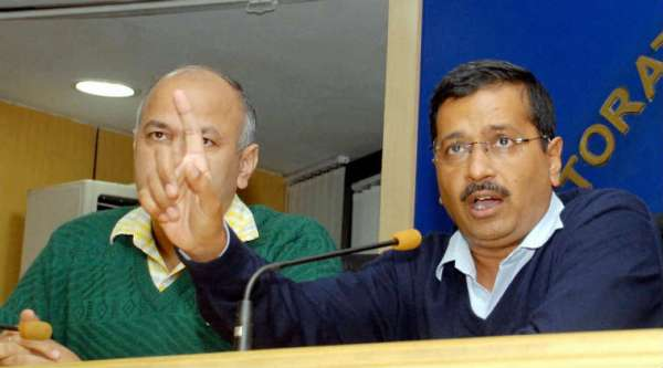 Delhi Chief Minister Arvind Kejriwal with Dy CM Manish Sishodia addresses a press conference on school admissions in New Delhi on Wednesday. (Photo: AP)