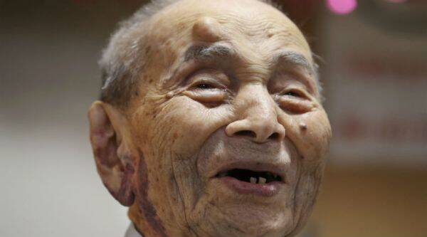 Yasutaro Koide smiles upon being formally recognized as the world's oldest man by the Guinness World Records at a nursing home in Nagoya, central Japan. The world's oldest man has died at the age of 112, two months short of his 113th birthday. The Ministry of Health, Labor and Welfare said he died early Tuesday, Jan. 19, 2016. / AP