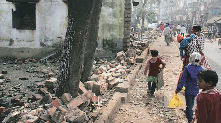 The broken boundary wall of Kaliachak police station on Tuesday. (Express Photo by: Partha Paul)
