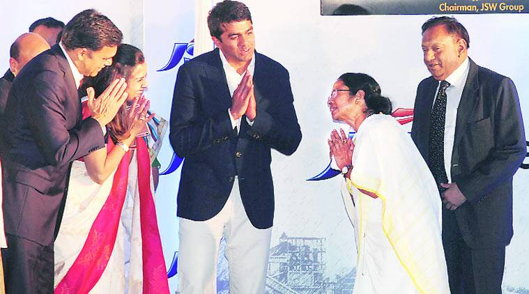 (Above) Chief Minister Mamata Banerjee with the Jindal family at Salboni on Wednesday. Security personnel on alert at Kuturia village near Salboni. Subham Dutta
