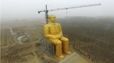 Mao's 36 metre-high gold-painted statue comes up in China village