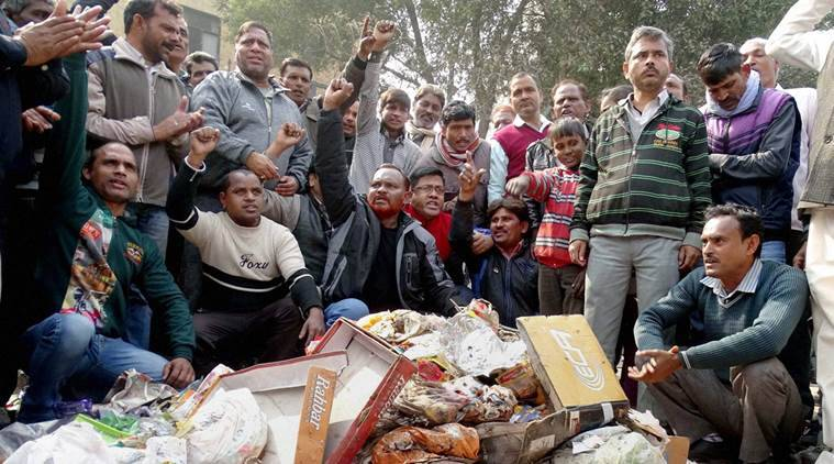 New Delhi: MCD workers shot slogans while piling up garbage near Deputy Chief Minister Manish Siosodia's office during a protest over their their demands in East Delhi on Thursday. PTI Photo (PTI1_28_2016_000053A) *** Local Caption ***