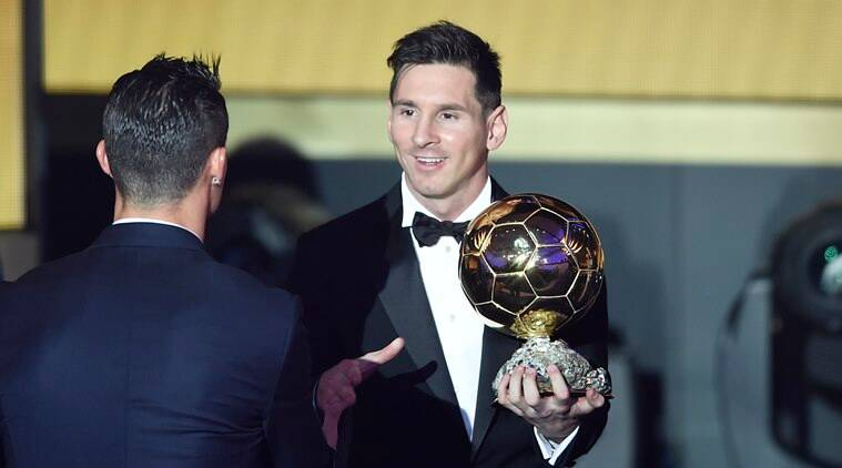 Argentina's Lionel Messi, right, speaks with Portugal's Cristiano Ronaldo, left, after winning the FIFA Men's soccer player of the year 2015 prize during the FIFA Ballon d'Or awarding ceremony at the Kongresshaus in Zurich, Switzerland, Monday, January 11, 2016. (Valeriano Di Domenico/KEYSTONE via AP))