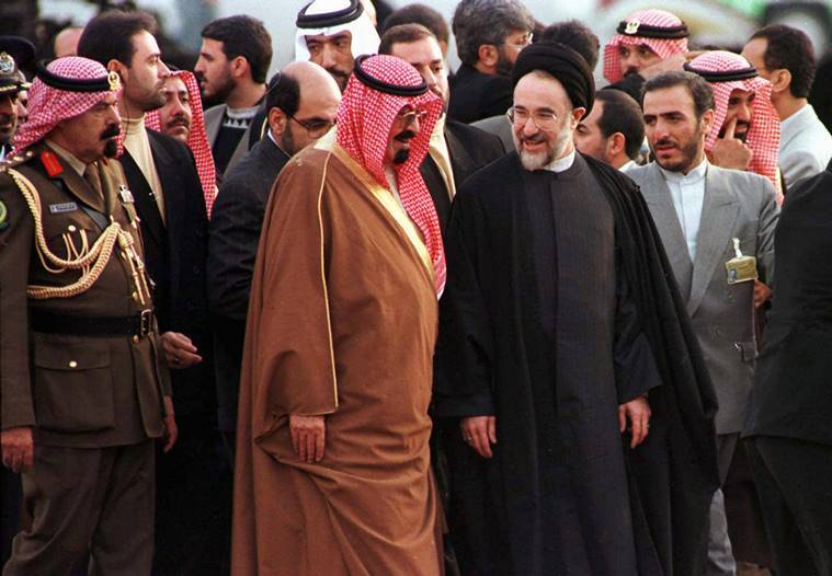 In this Dec. 8, 1997 file photo, Saudi Arabia Crown Prince Abdullah Bin Abdul Aziz Al-Saud, center left, is greeted at Mehrabad Airport in Tehran by Iranian President Mohammad Khatami, center right, ahead of the Islamic Conference in the Iranian capital. (AP Photo/File)